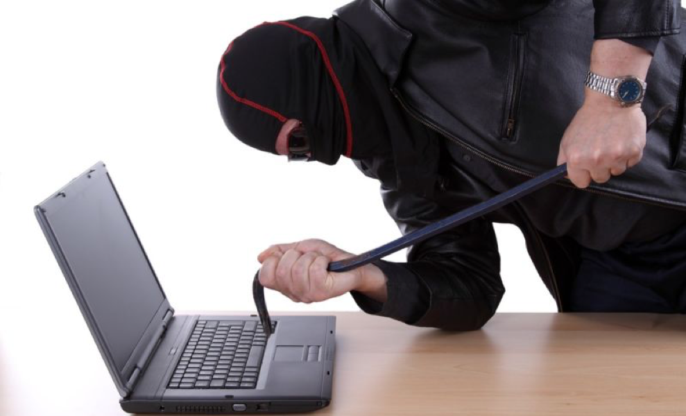 hacker attacking computer with a crowbar