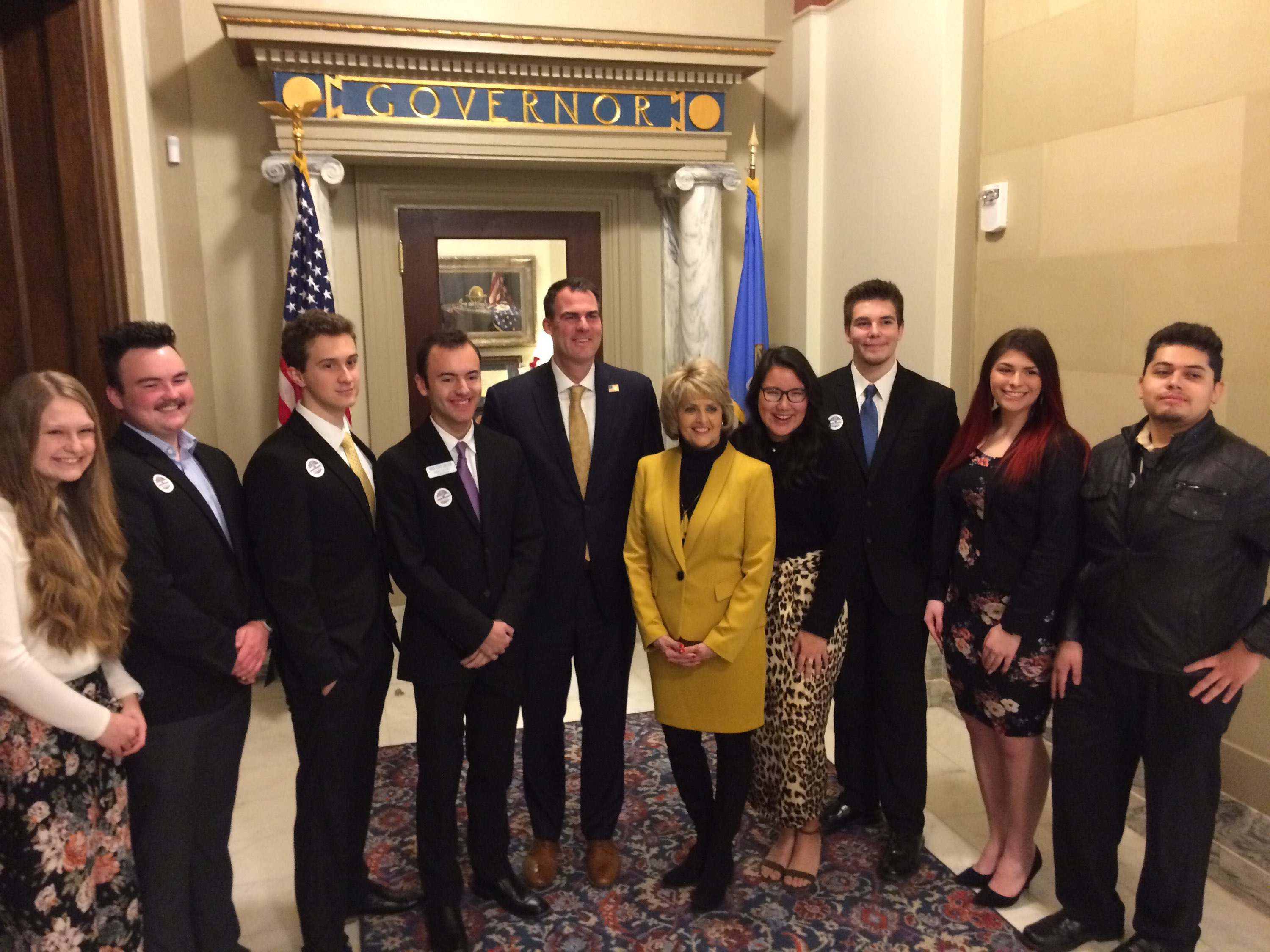 Photo caption: Rose State College President, Dr. Jeanie Webb, pictured with Rose State students and Oklahoma Governor Kevin Stitt.