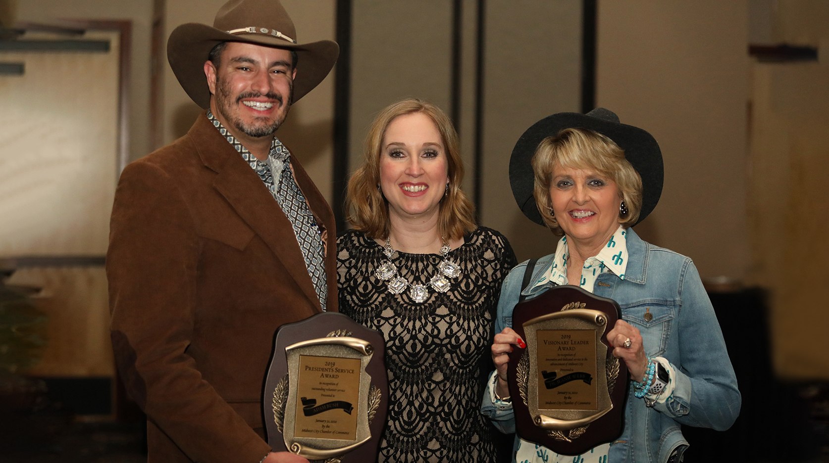 Pictured in the photo are Adam Bush, Christine Martin 2019 Midwest City Chamber President and President Webb.