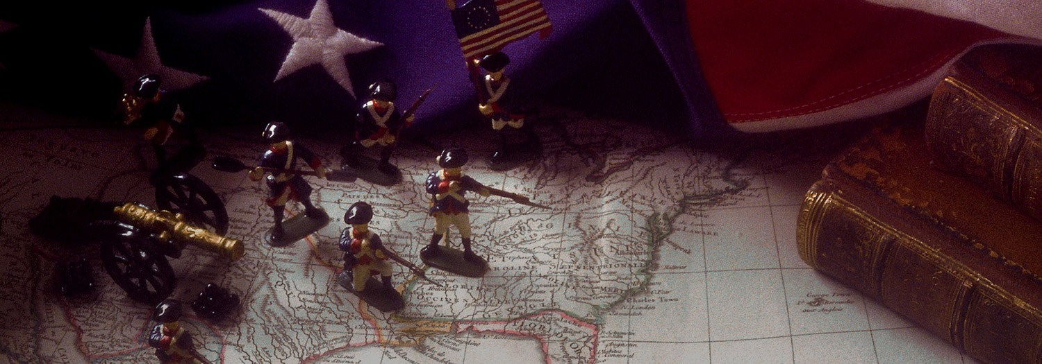 Miniatures of British soldiers against a map and US flag