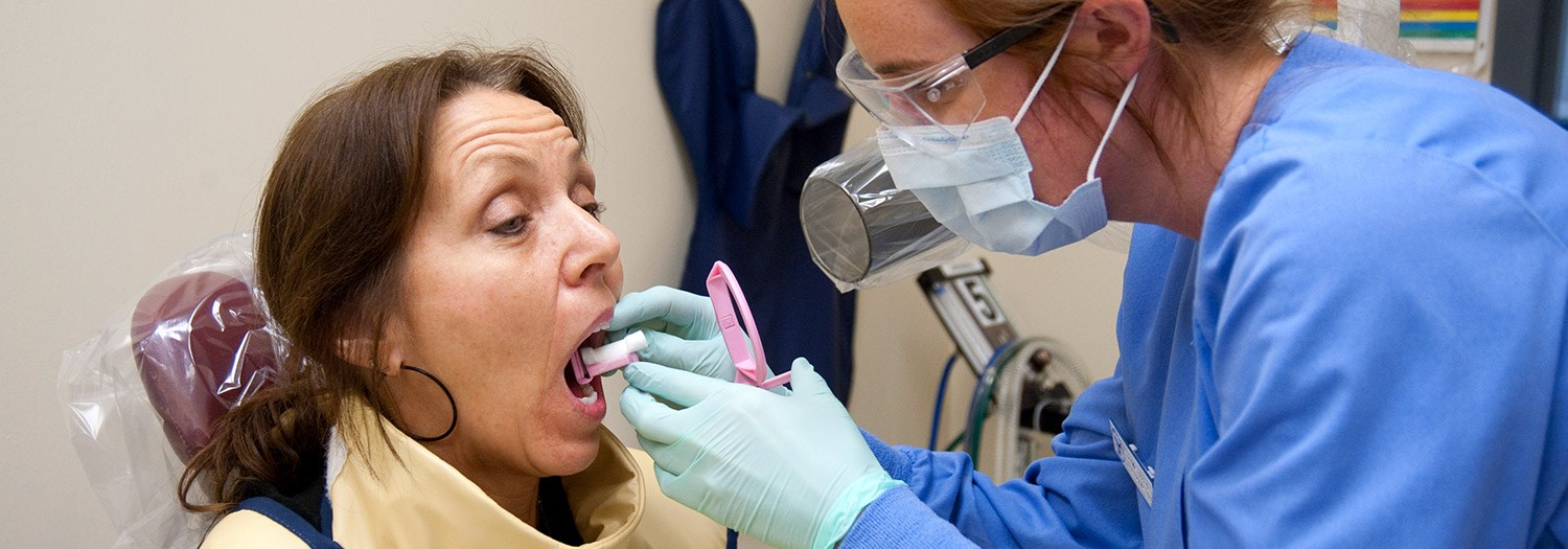 patient in lab getting a dental impression