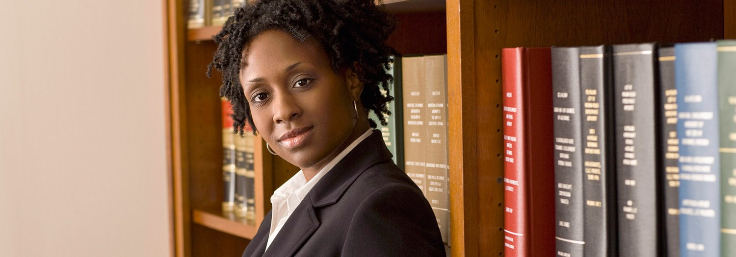 young black lady in a law library