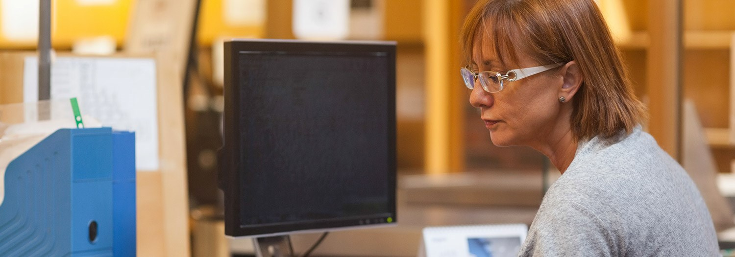 student sitting in front of a computer monitor
