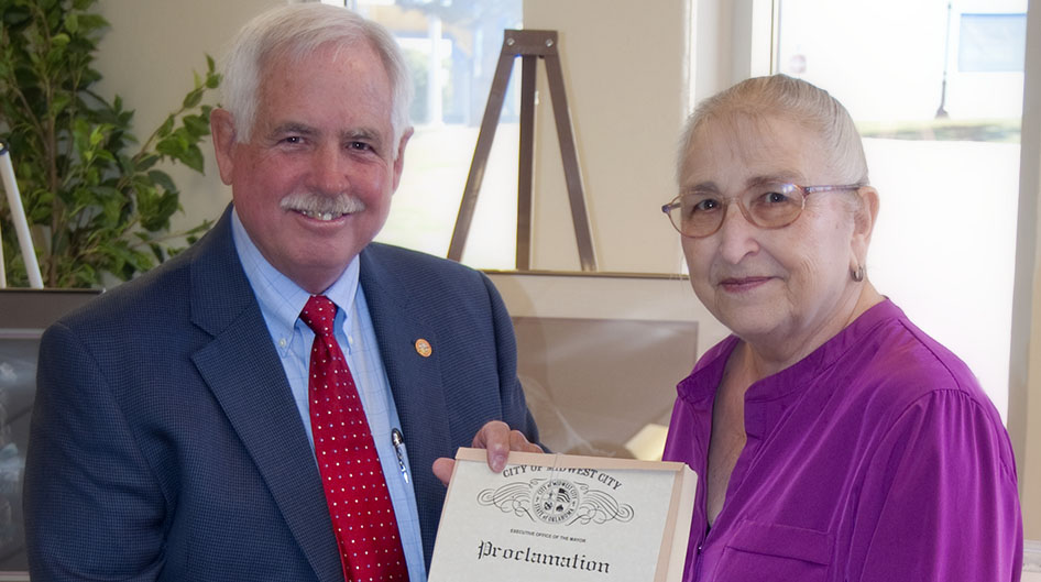 Carolyn Martin being presented a proclamation by Mayor J.D. Collins
