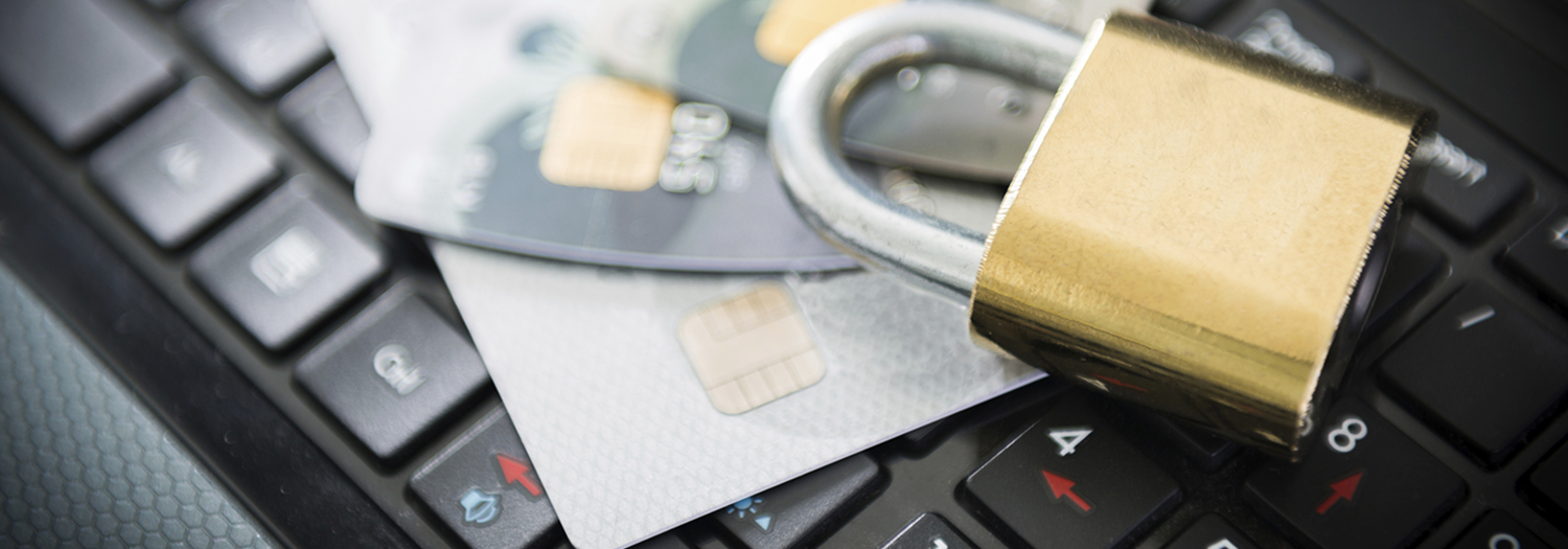 Padlock and credit card on top of keyboard