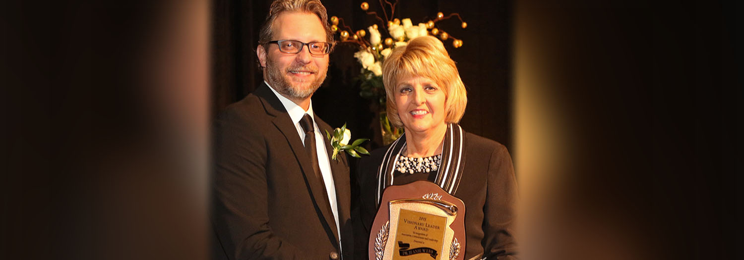 Mr. Wade Moore, 2015-2015 President, Midwest City Chamber of Commerce and President, Advantage Bank Midwest City presents Rose State College President, Jeanie Webb with the 2015 Visionary Leader Award at the Annual Midwest City Chamber Banquet.  Photo courtesy of Midwest City Beacon staff