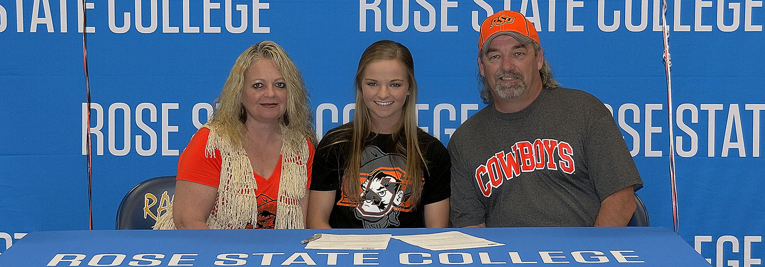 Lauren Mason signs with OSU at a ceremony attended by her parents (pictured as well).