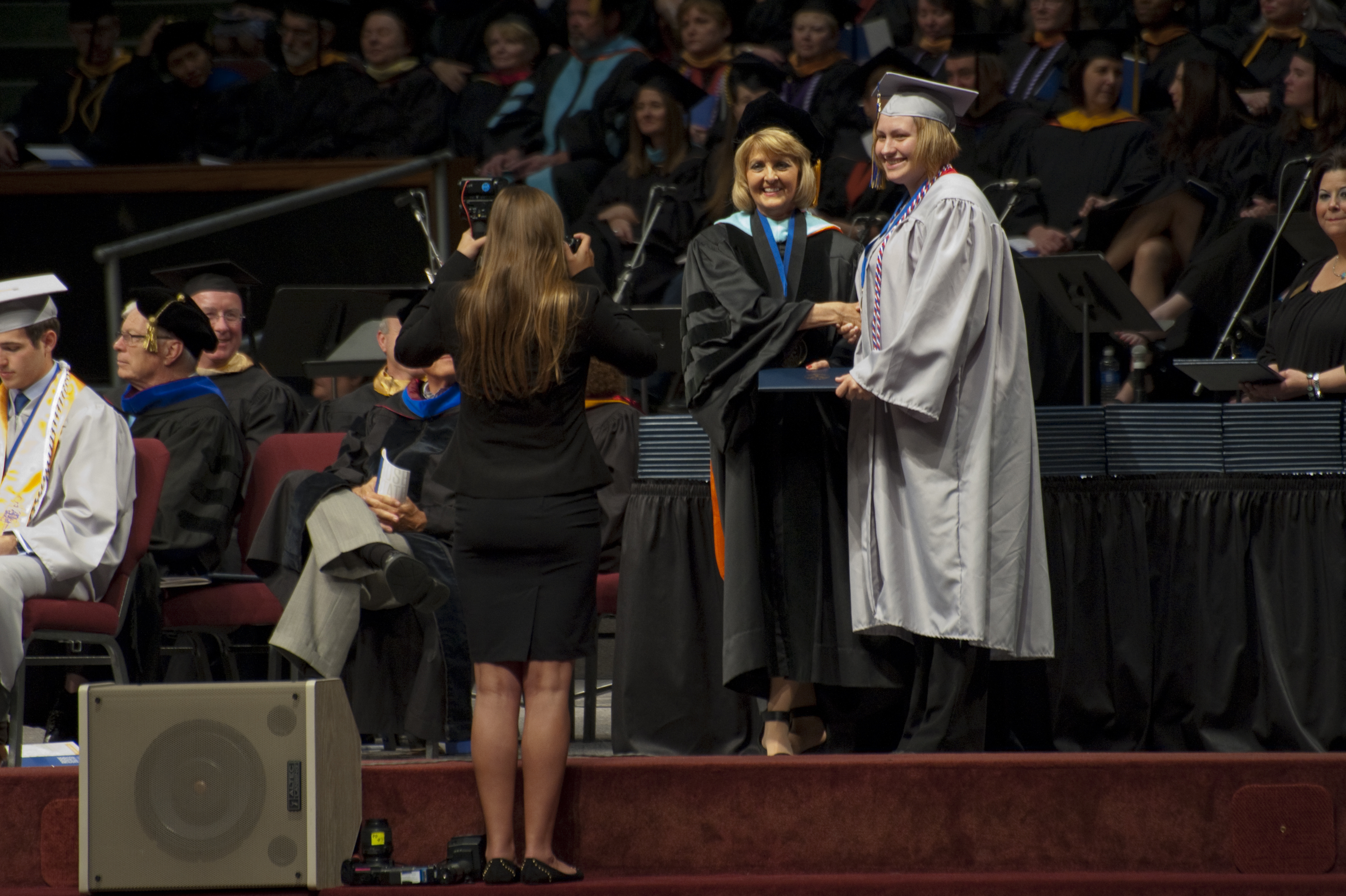 President Webb conferring degree at graduation