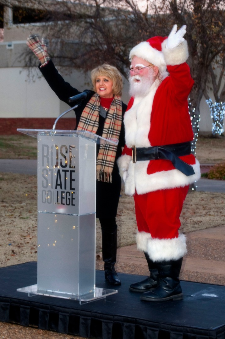 President Jeanie Webb and Santa Claus address attendees at the 2015 Holiday Lighting