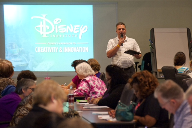 Participants take notes at Rose State's 2016 Disney Institute training on Creativity & Innovation