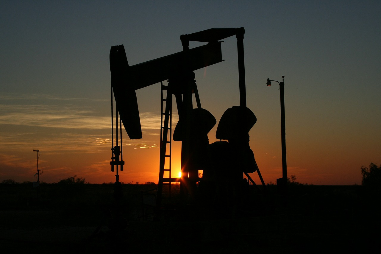 An oil pumpjack at sunset
