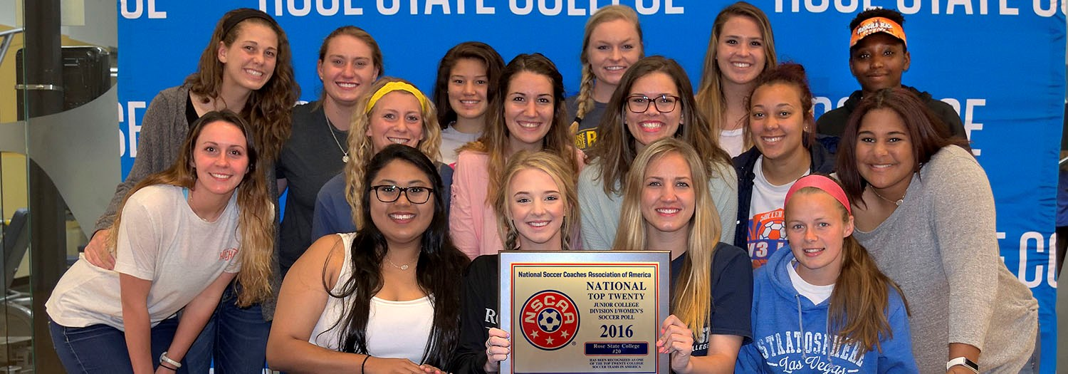 Women's soccer team and plaque for top 20 team