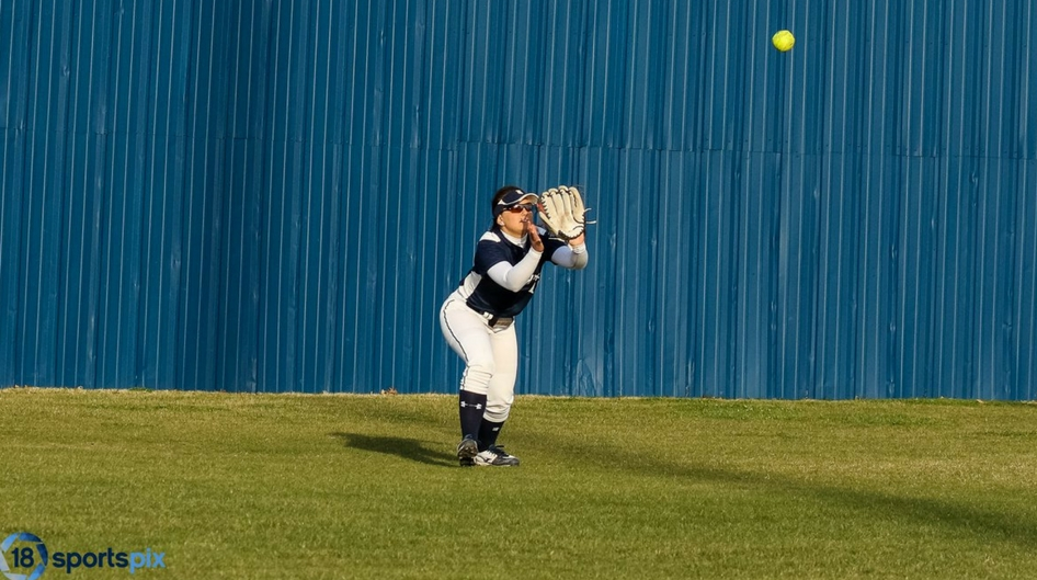 Rose State softball player catches a fly ball