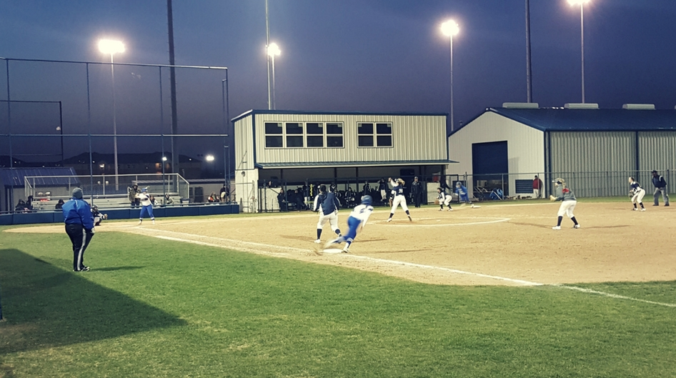 An evening softball game at Rose State College