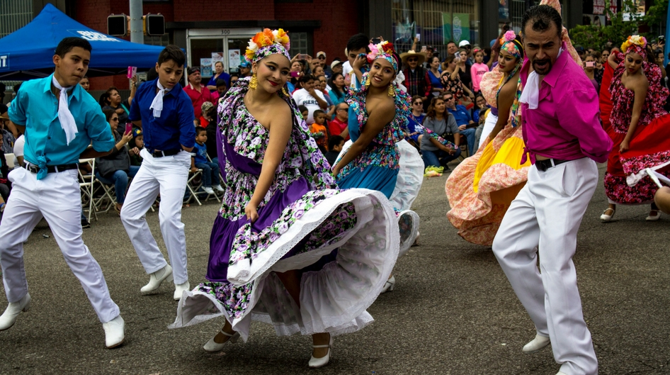 Latin dancers dancing in the street during a festival