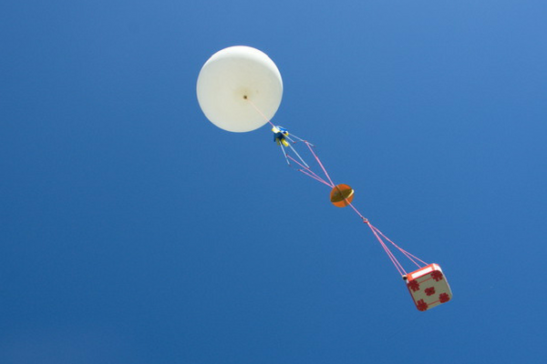 High altitude balloon flying on a blue sky