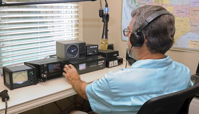 amateur radio operator at his radio