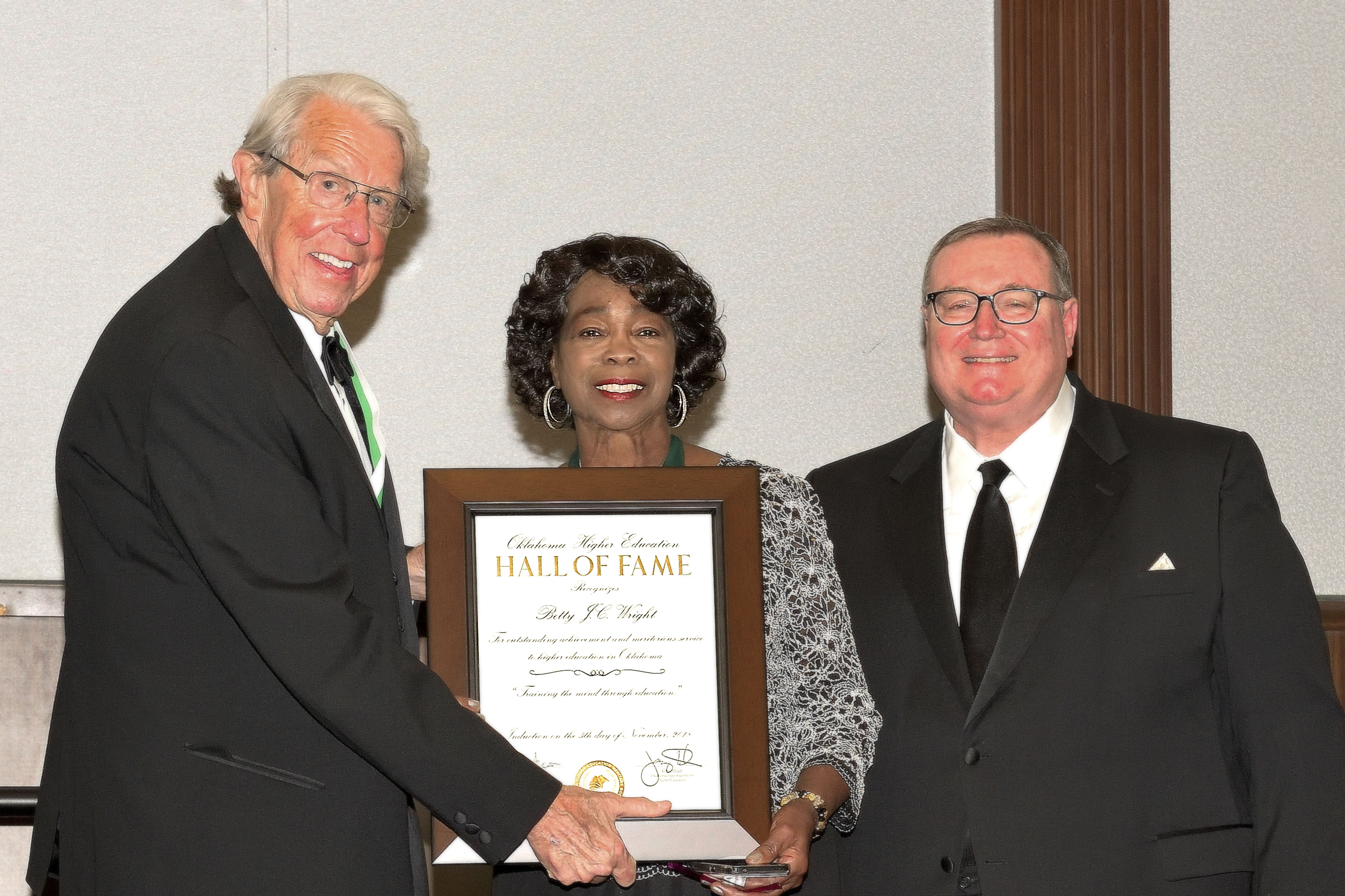 Rose State College Regent Betty J.C. Wright poses with her Oklahoma Education Hall of Fame award with John Feaver, President, Oklahoma Higher Education Heritage Society and Glen D. Johnson, Chancellor of the Oklahoma State Regents for Higher Education.