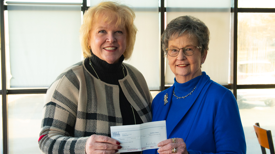 cindy mikeman receiving endowment check